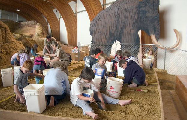 Kids dig learning at The Mammoth Site | Black Hills Travel Blog