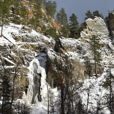 Sunlit Falls on a Snowy Day