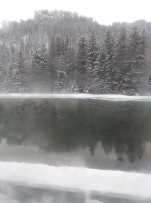 Snow Reflection On Pond